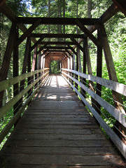 [image:Julie/flickr] Wooden bridge on Iron Goat Trail.