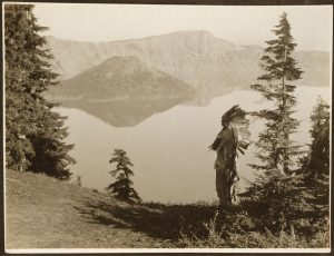 (images:vitamininmotion/flickr) Title: The chief--Klamath. Date Created/Published: c1923. Summary: Photograph shows Klamath Indian chief in ceremonial headdress standing on hill overlooking lake, California or Oregon. Photograph by Edward S. Curtis, Curtis (Edward S.) Collection, Library of Congress Prints and Photographs Division Washington, D.C.