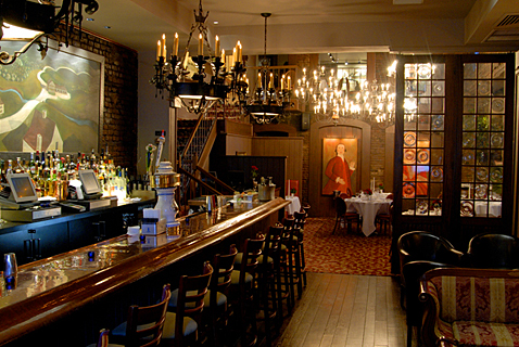 The bar counter at One If By Land, Two If By Sea