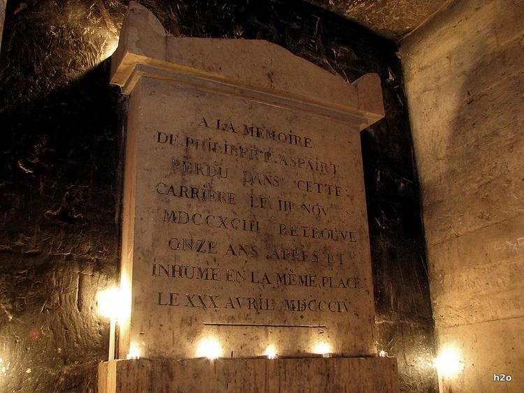 The tomb of Philibert Aspairt at the Catacombs of Paris is located where his body was found
