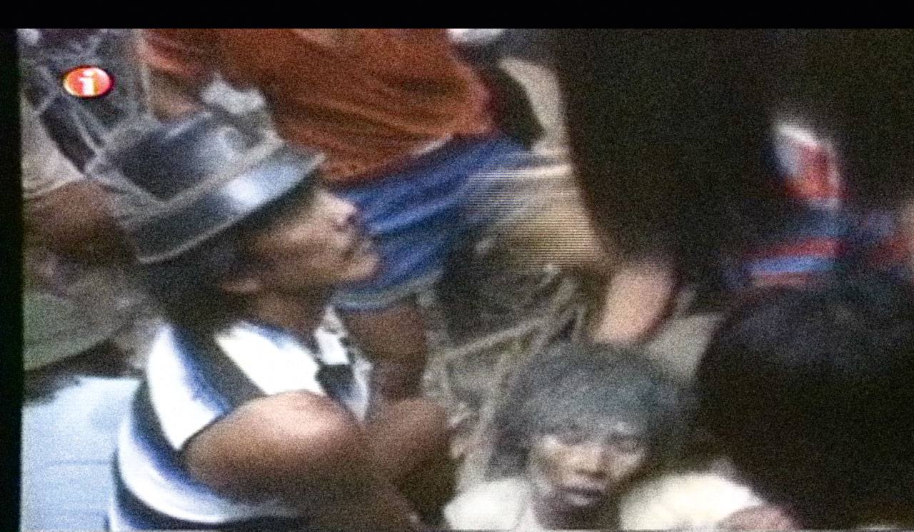 A photo from a video that emerged years after the collapse of the Manila Film Center showing one of the workers buried
