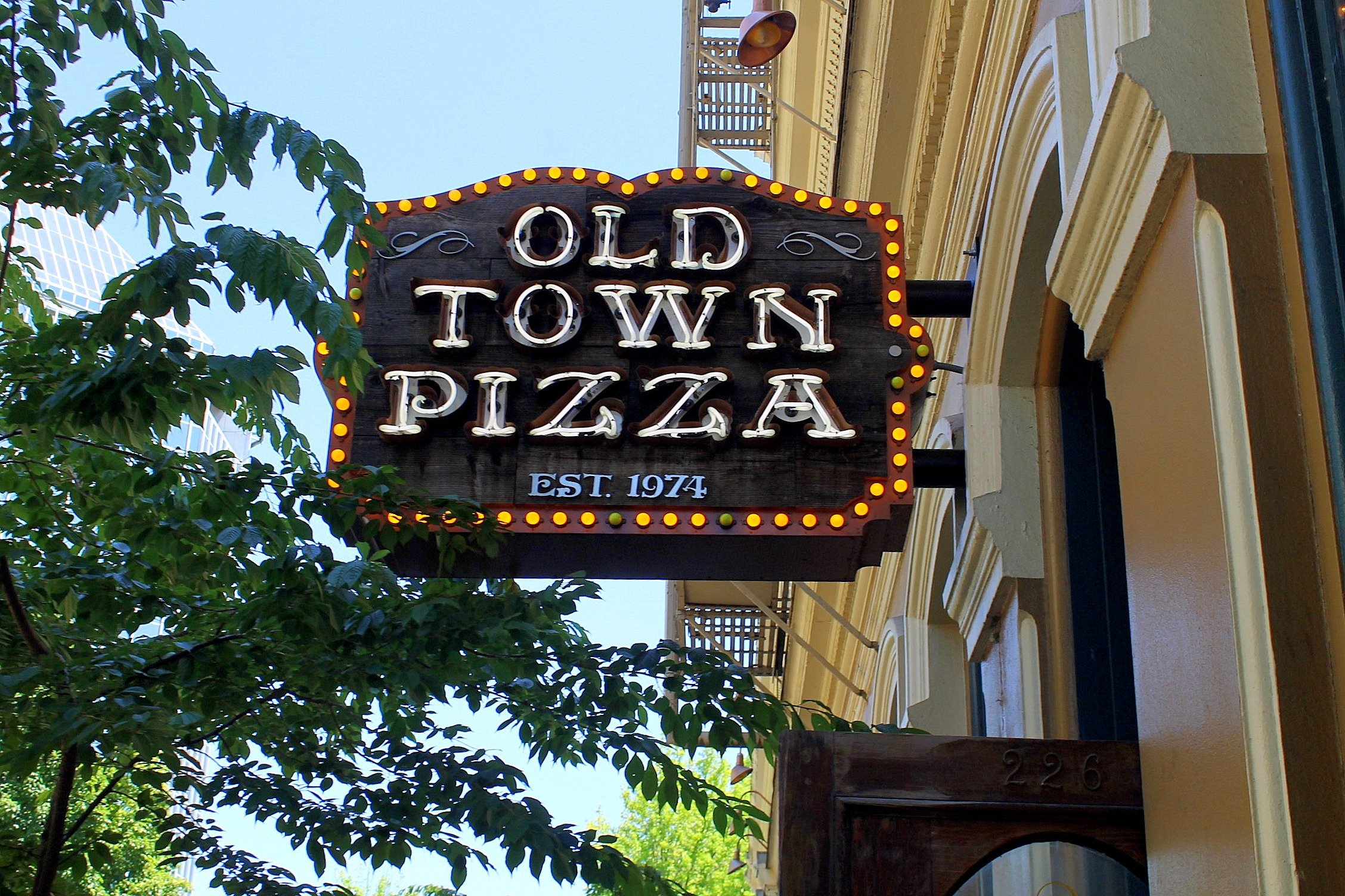 A photo showing a sign of Old Town Pizza in Portland