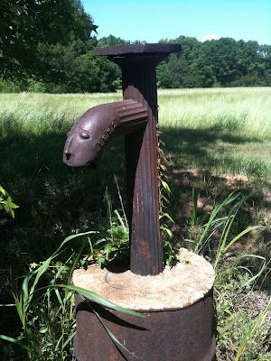 A photo of the wellhead with a face in Cahawba