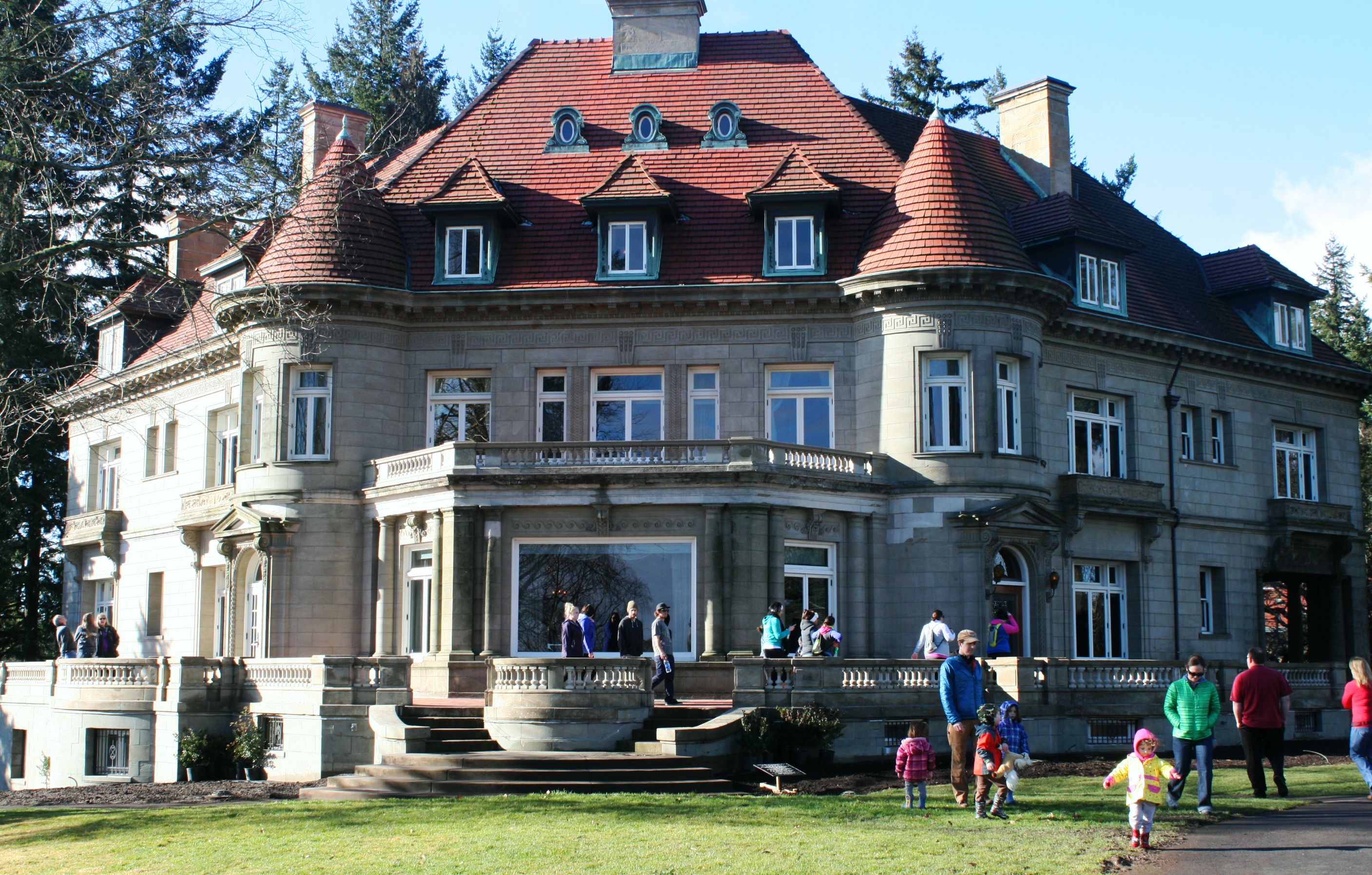 Visitors going in and outside the Pittock Mansion