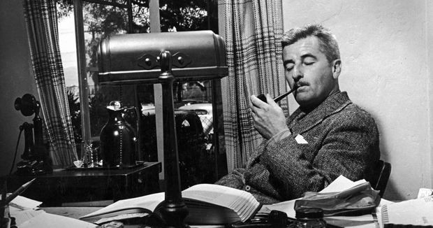 William Faulkner using his pipe in an undated photo