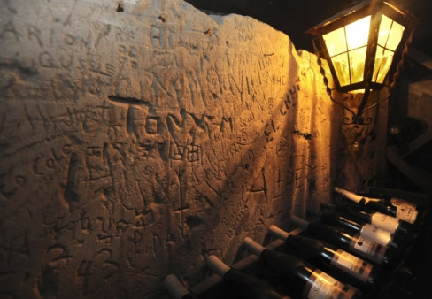 Some carvings on the wall of the El Adobe de Capistrano wine cellar