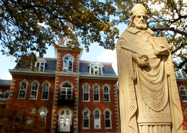 A statue in front of Ambrose Hall