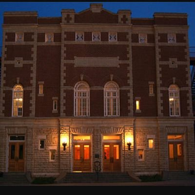 A photo of the Brown Grand Theatre at night