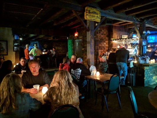 A photo of the tables lit by candles at the Lafitte's Blacksmith Shop