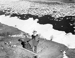 An old aerial photo of Big Bay Point Lighthouse