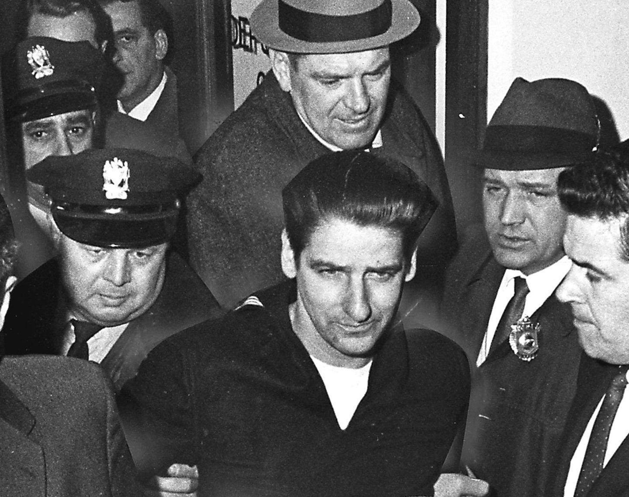 Albert De-Salvo surrounded by police and other authorities