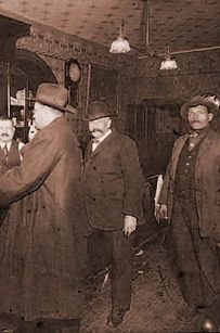 An 1861 photo of people inside Arnold's Bar and Grill