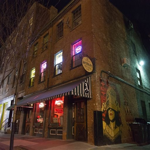 The facade of Arnold's Bar and Grill at night